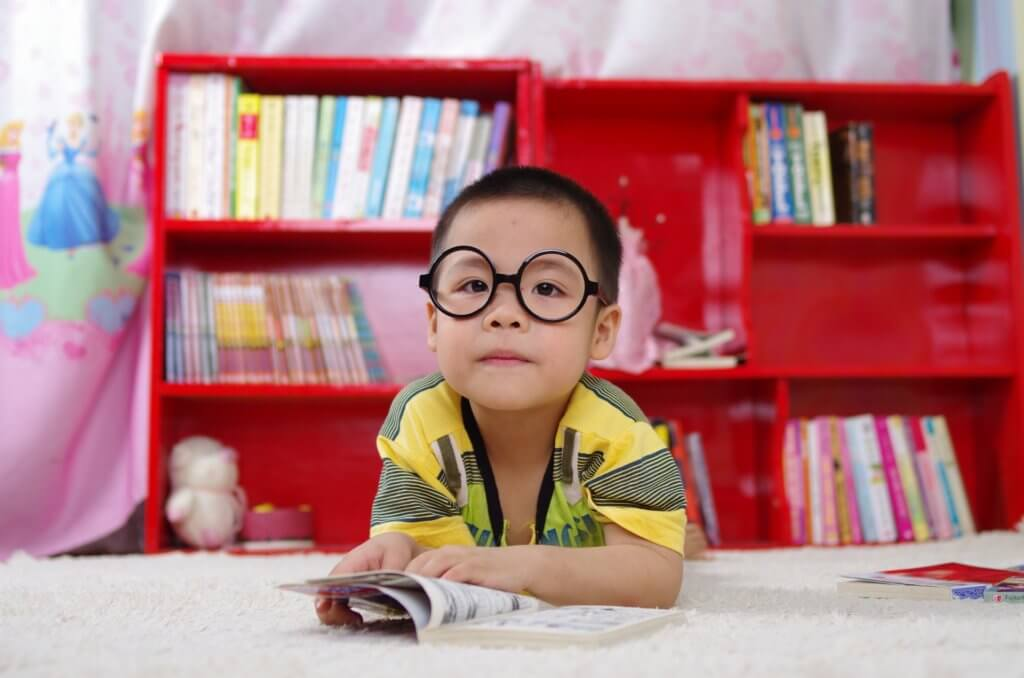 Chinese kid reading book